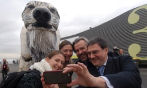 People pose with a giant polar at the Paris climate change COP21 summit on 11 December 2015.