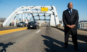 The late Rep. John Lewis, D-Ga., stands on the Edmund Pettus Bridge in Selma in 2015. He had been beaten by police on the bridge fifty years earlier.