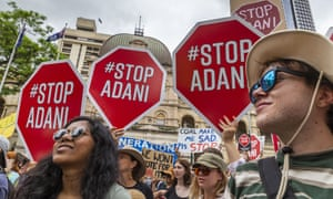 People protest against Adani in Brisbane.