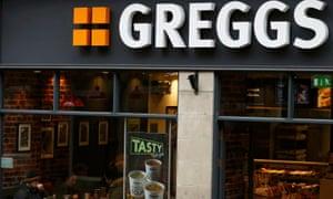 Customers sit inside a Greggs bakery in Britain.