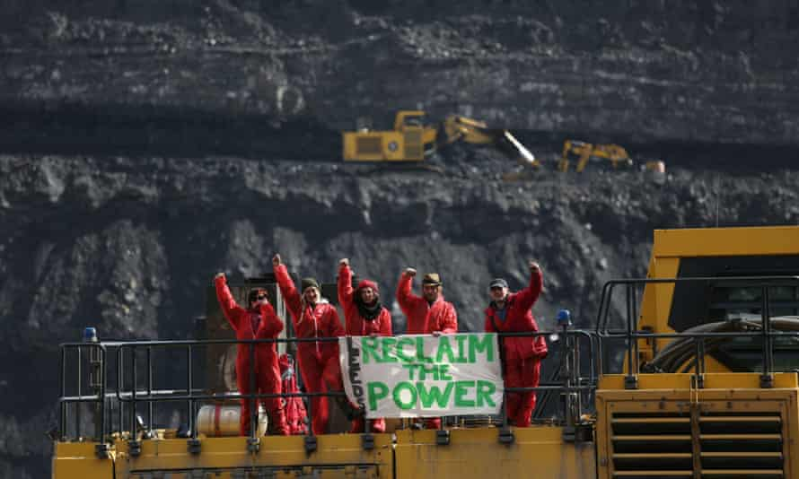 Hundreds of environmental activists invaded the UK's largest opencast coal mine in south Wales on Tuesday.