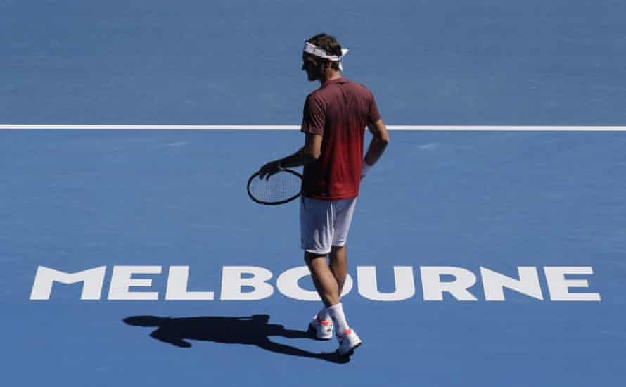 Switzerland's Roger Federer prepares to serve during a practice session before the Australian Open tennis championships in Melbourne.