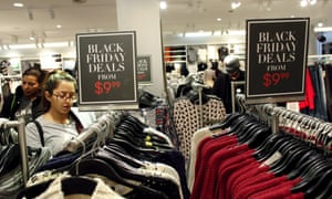 Costumers visit a H&M store at the Newport Mall