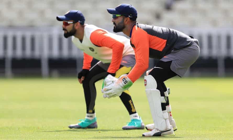 Dinesh Karthik (right) and Virat Kohli at Edgbaston during India's 2018 tour of India.