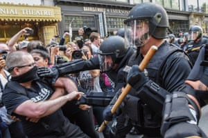 Counter protesters clash with police.