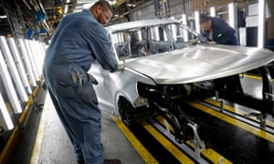 Workers assemble cars at the newly renovated Ford's Assembly Plant in Chicago.