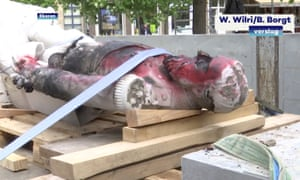 Focus of fury … a damaged statue of former Belgian King Leopold II.