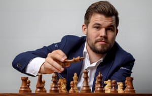 Magnus Carlsen, the chess world champion from Norway, taking part in simultaneous games with 21 opponents at the Four Season Hotel - he beat them all in just over an hour.