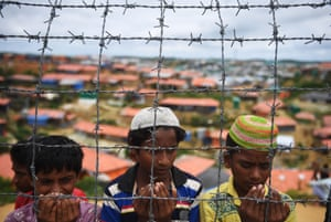 Rohingya refugees perform prayers on the anniversary of a military crackdown that prompted a massive exodus of people from Myanmar.