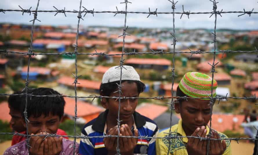 Rohingya refugees perform pray in the Kutupalong refugee camp, Bangladesh.