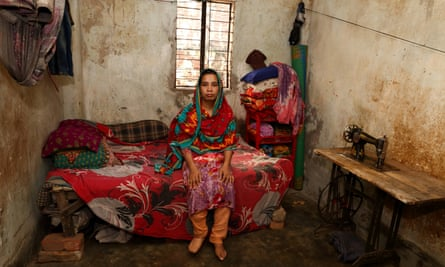 Bangladeshi garment worker Shima, 26, at her home in Dhaka. Shima lost her foot to infection and now wears a prosthetic. An Oxfam report found women who work for Australian brands are unable to feed their families or get treatment when ill.