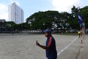 Kolsindur school's football coach, Mofiz Uddin, gestures to his players