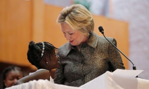 Nine-year-old Zianna Oliphant joins Hillary Clinton at the pulpit at the Little Rock AME Zion church in Charlotte, North Carolina.