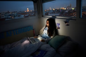 A teenage girl self-isolates in her room in Madrid, Spain