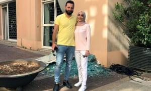 Israa Seblani poses for a picture with her husband Ahmad Subeih in Beirut in the same place where they were taking their wedding photos when the blast rocked the city.