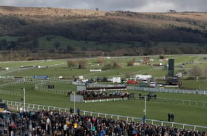 Runners in the third race jump the first fence in the home straight which has been moved for safety reasons