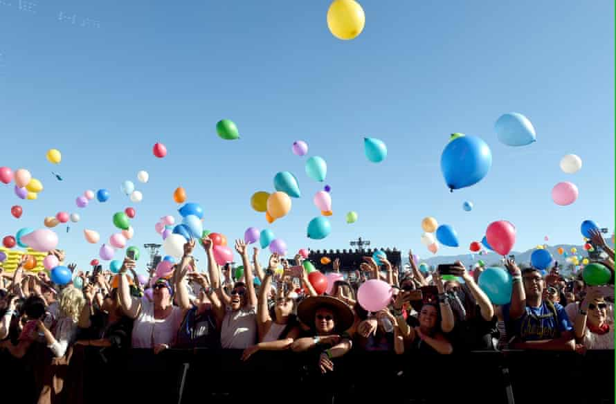 Festivalgoers are showered with balloons during Matt and Kim's set.