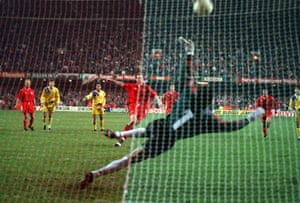 Wales defender Paul Bodin thwacks his penalty against the bar and the ball flies away from the danger area. Wales went on to lose the game 2-1 and miss out on USA 94.