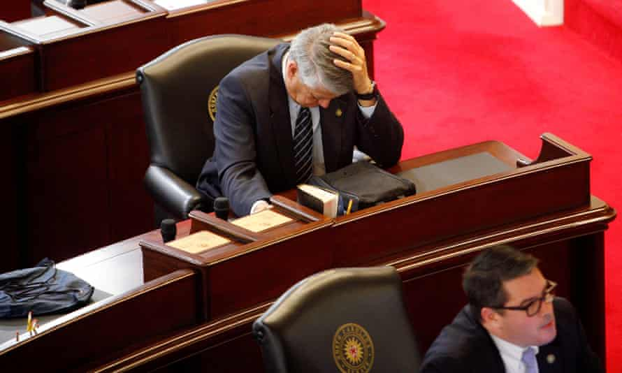 Republican state senator Norman Sanderson holds his head during a failed attempt to repeal HB2 in Raleigh, North Carolina Wednesday.