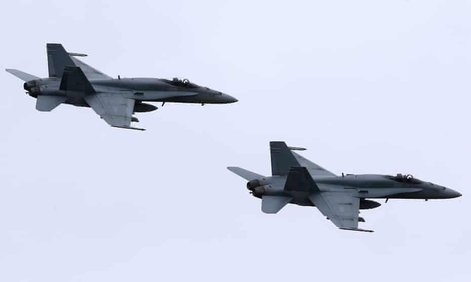 Canadian fighter jets during a Nato flyover in Romania. Canada will reportedly send 1,000 soldiers in Latvia.