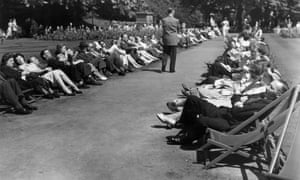 Office workers relaxing in deck chairs in Embankment Gardens, London during their lunch break, 1953.