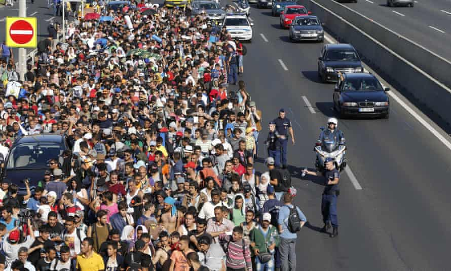 Migrants walking out of Budapest in the direction of Vienna