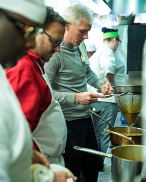 Brandon Edwin Chrostowski, founder, president and CEO of Edwins Leadership & Restaurant Institute, prepares a meal.