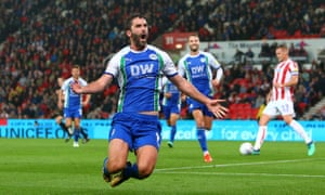 Wigan's Will Grigg celebrates scoring his side's third goal, completing a comprehensive away win against struggling Stoke.