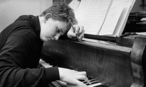 Oliver Knussen works at the piano