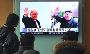 People watch a television news report showing pictures of US president Donald Trump and North Korean leader Kim Jong-un in Seoul
