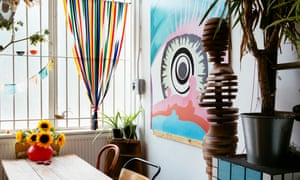 Magpie's eye: a bright picture of an eyeball, mannequin and other bits and pieces in the kitchen at Alex Noble's flat.