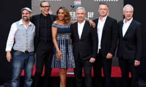 The cast and director of Independence Day: Resurgence, book-ended by the film's gay couple, played by John Storey and Brent Spiner.