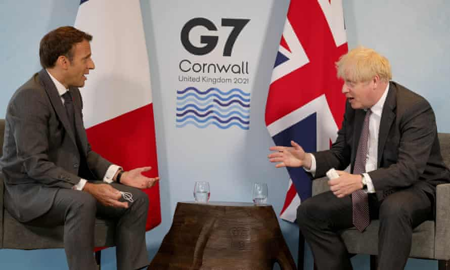 Boris Johnson and the French president, Emmanuel Macron, at the G7 summit in Cornwall.