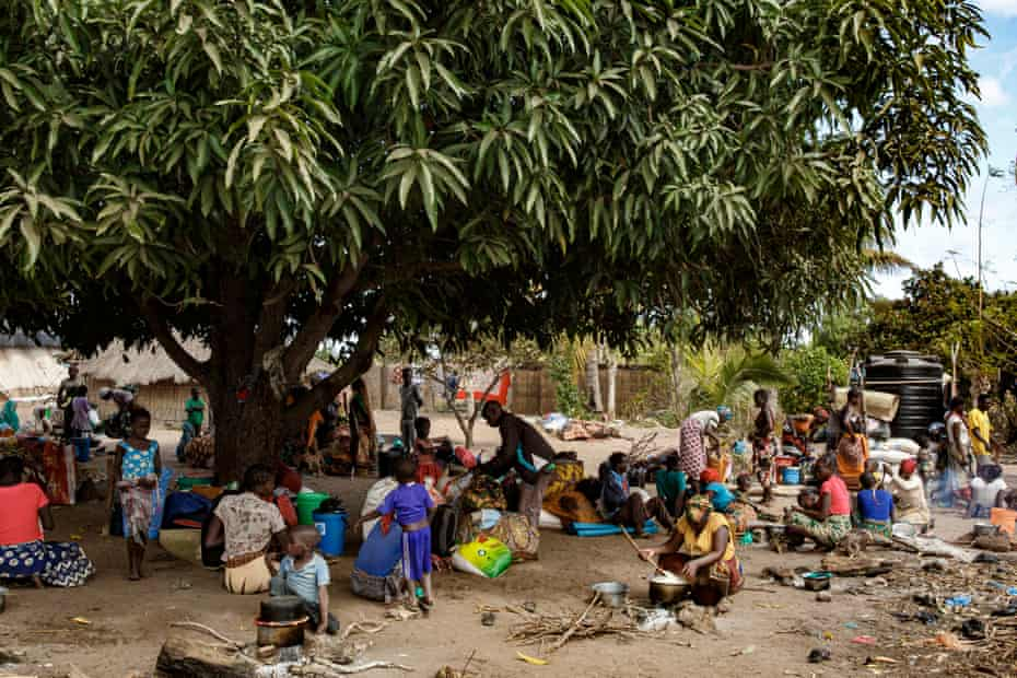 New arrivals, displaced by the conflict wait at the entrace of Ntele resettlement area, which is full - near Montepuez, Cabo Delgado.
