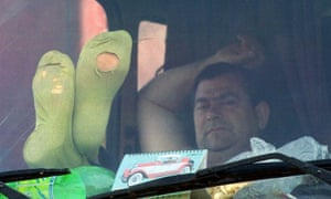 A driver grabs some rest in his cab