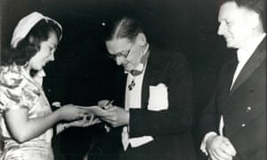 TS Eliot, centre, watched by Crown Prince Gustav of Sweden, signs an autograph for an admirer after receiving the Nobel prize for literature in Stockholm in 1948.