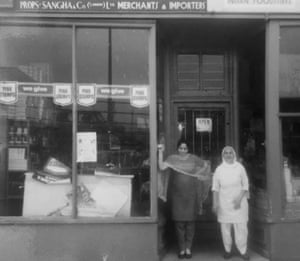 Pritam Singh Sangha's wife, Bakshish Kaur Sangha (left), and his mother outside the family shop circa 1958.