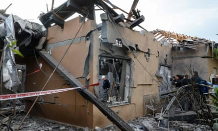 The house hit by a rocket in Mishmeret, north of Tel Aviv on Monday. Six people were injured.