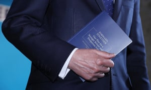 The chancellor, Philip Hammond, carrying a copy of the Conservative party's election manifesto at the launch of the document in May.