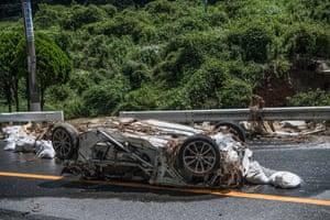 A car destroyed by a landslide in Yanohigashi, near Hiroshima