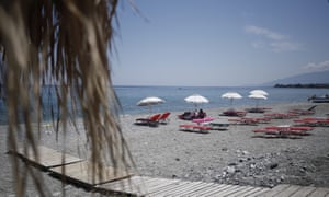 Empty sunbeds and few tourists are seen on the beach of Leptokarya, Katerini.