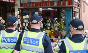 Members of the Victorian Police pay their respect to Pellegrini's co-owner Sisto Malaspina who was killed on Friday after he was attacked by a lone terrorist on Bourke Street.