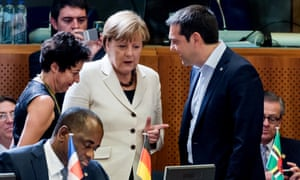 Alexis Tsipras speaks with Angela Merkel during a round table meeting at the EU-CELAC summit in Brussels today.