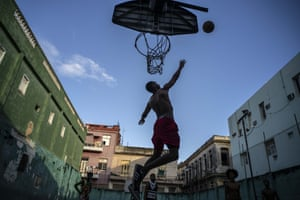People play at a basketball court in Havana, Cuba