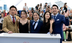 Director Park Chan-Wook (centre) and his cast at the Cannes film festival photocall for The Handmaiden