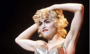 Madonna poses on-stage during the 'Blonde Ambition' tour in 1990
