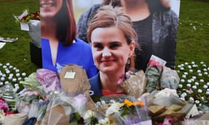 Flowers and tributes placed by a photo of Jo Cox in Parliament Square after she was killed.