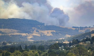 Smoke billows from a bushfire south of Huonville in southern Tasmania, where three homes have been destroyed