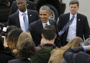 Barack Obama smiles as he greets guests after arriving on Air Force One at San Francisco International Airport.