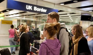 Young people waiting to enter the UK at immigration, Terminal 3, Heathrow airport.